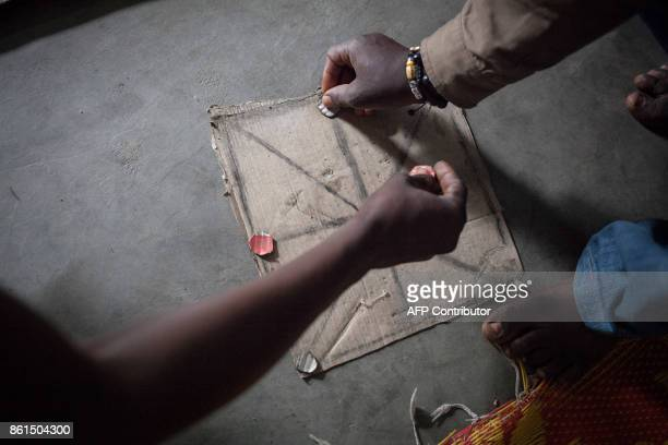 Inmates of the Bouar detention centre play a game in their prison cell in Bouar western Central African Republic on October 13 2017 In the Central...