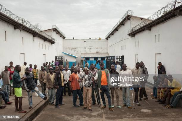 Inmates of the Bouar detention centre pose for a photograph in the courtyard of the prison in Bouar western Central African Republic on October 13...