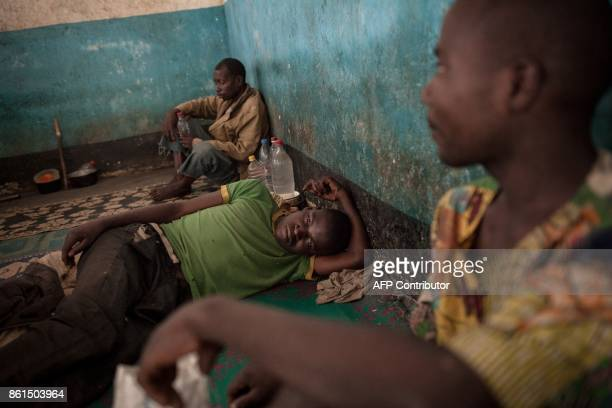 Inmates of the Bouar detention centre rest in their prison cell in Bouar western Central African Republic on October 13 2017 In the Central African...