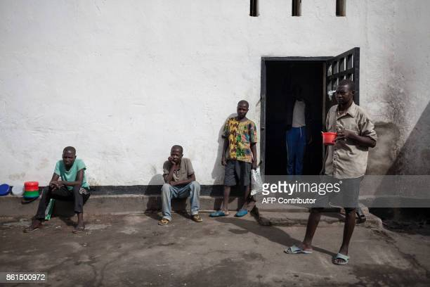 Inmates of the Bouar detention centre stand in the courtyard of the prison in Bouar western Central African Republic on October 13 2017 In the...