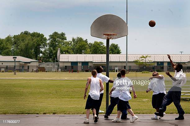 Inmates play basketball in the yard of the North Central Correctional Institution in Marion Ohio US on Wednesday June 15 2011 As Ohio tries to close...