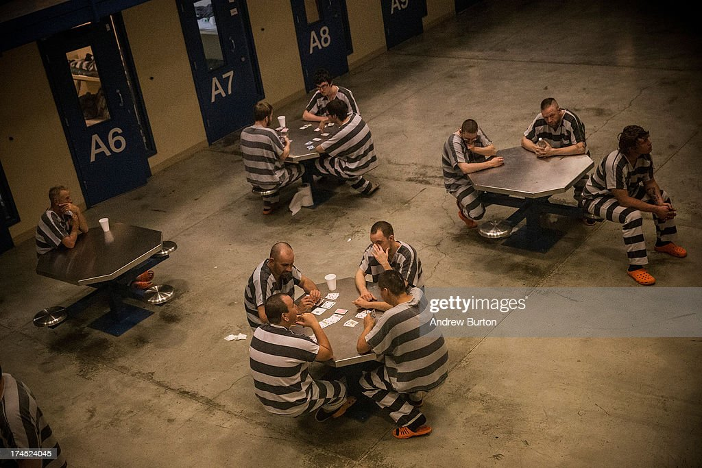 Inmates sit in the county jail on July 26, 2013 in Williston, North Dakota. The state has seen a rise in crime, automobile accidents and drug usage recently, due in part to the oil boom which has brought tens of thousands of jobs to the region, lowering state unemployment and bringing a surplus to the state budget.
