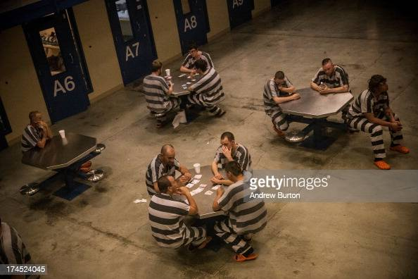 Inmates sit in the county jail on July 26 2013 in Williston North Dakota The state has seen a rise in crime automobile accidents and drug usage...