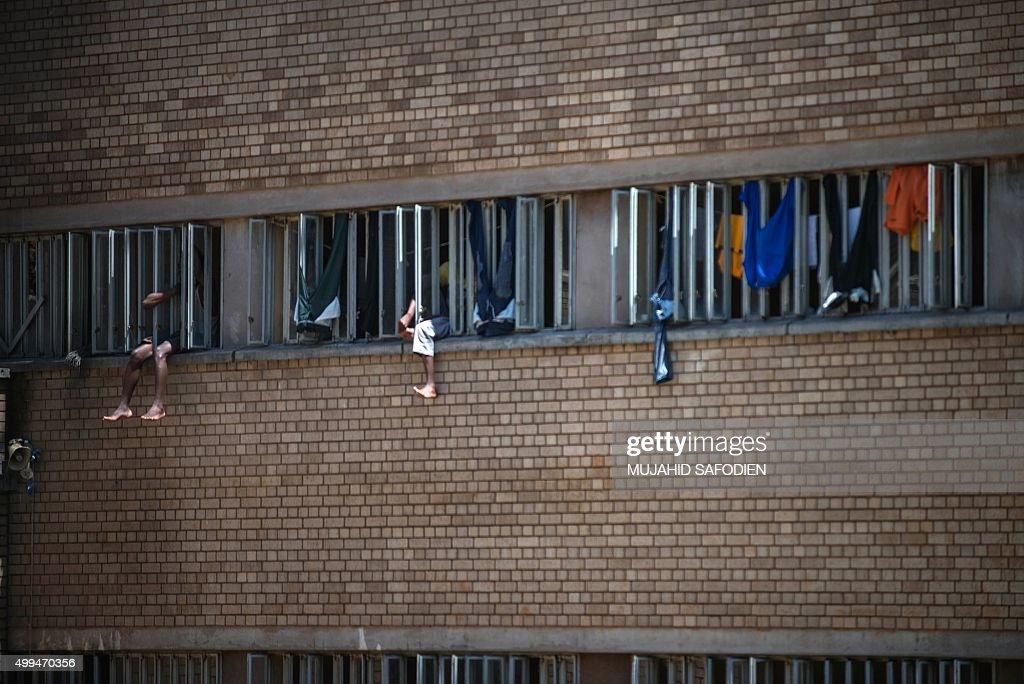 Sit In Window inmates sit on the window of their cell in the kgosi mampuru ii