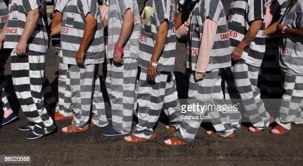 Inmates walk as they are moved after being ordered by Maricopa County Sheriff Officer Joe Arpaio to be placed into new housing to open up new beds...
