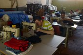 Inmates work at the tailoring workshop of the Apanteos prison in Santa Ana 66 km west of San Salvador on July 15 2016 Apanteos is a model prison in...