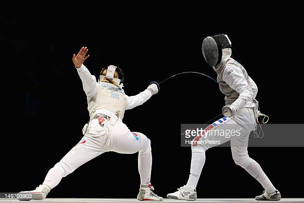 Inna Deriglazova of Russia and Arianna Errigo of Italy compete during the Women's Foil Team Fencing gold medal match on Day 6 of the London 2012...