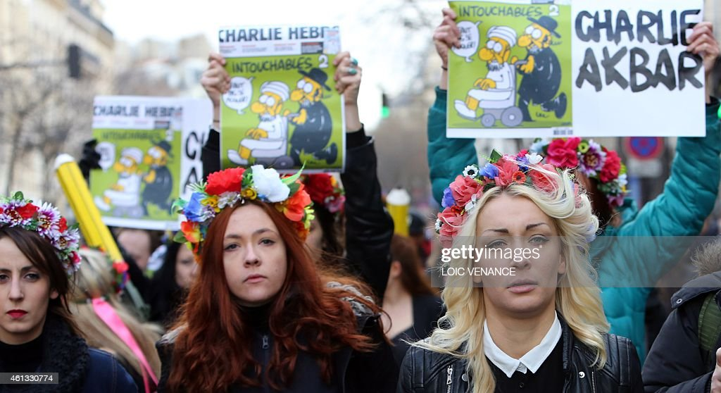 <a gi-track='captionPersonalityLinkClicked' href=/galleries/search?phrase=Inna+Shevchenko&family=editorial&specificpeople=7249613 ng-click='$event.stopPropagation()'>Inna Shevchenko</a>, leader of the women's rights organization Femen (R) takes part to Unity rally Marche Republicaine on January 11, 2015 at the Place de la Republique (Republique's square) in Paris in tribute to the 17 victims of a three-day killing spree by homegrown Islamists. The killings began on January 7 with an assault on the Charlie Hebdo satirical magazine in Paris that saw two brothers massacre 12 people including some of the country's best-known cartoonists, the killing of a policewoman and the storming of a Jewish supermarket on the eastern fringes of the capital which killed 4 local residents.