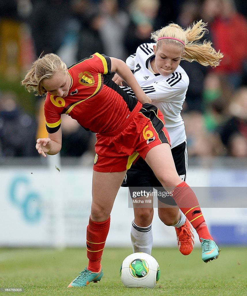 Inne De Smet (L) of Belgium and Nina Ehegoetz of Germany compete for the ball during the U17 Girls Euro Qualifier match between Germany and Belgium at Bioenergie-Arena on October 16, 2013 in Grossbardorf, Germany.