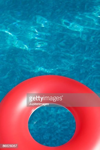 Swimming Pool Identification : Inner tube in swimming pool stock photo getty images