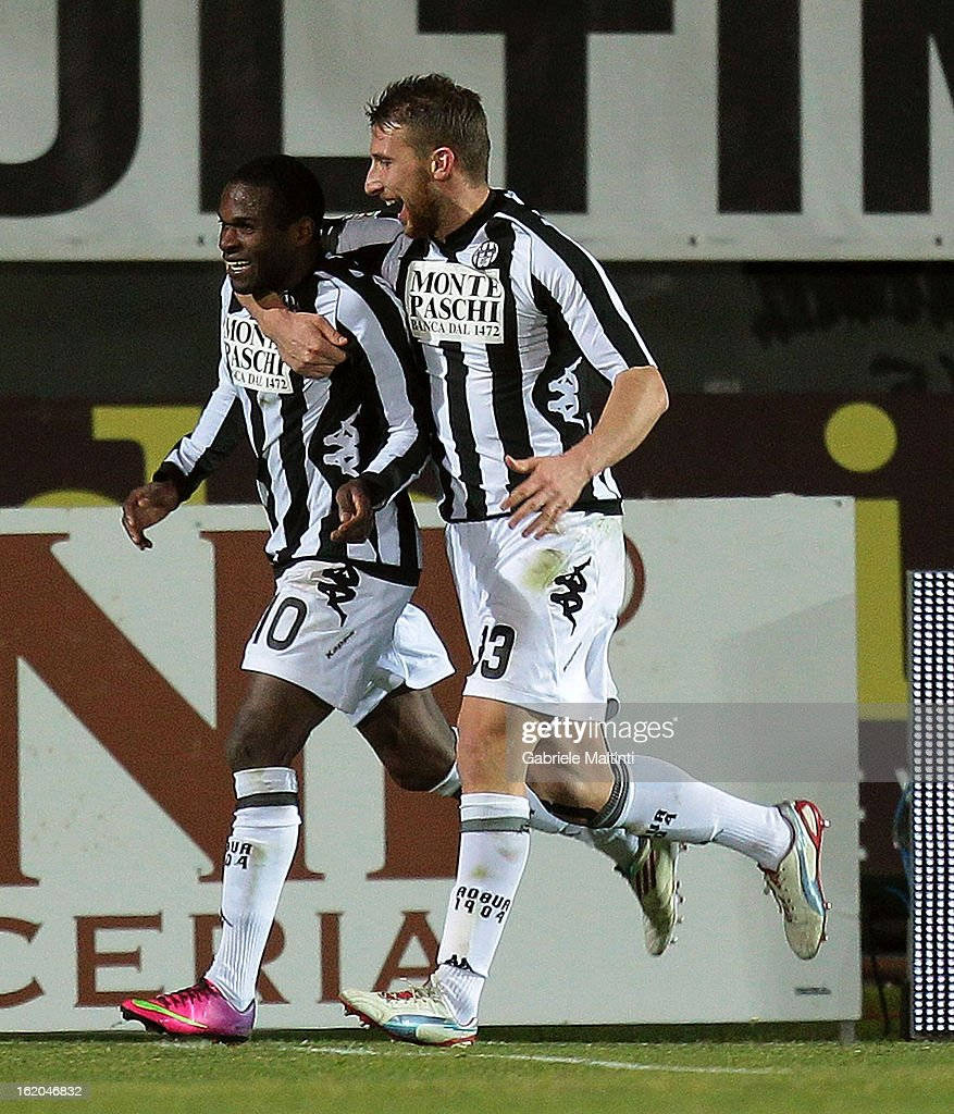 Innocent Emeghara (L) of AC Siena celebrates after scoring a goal during the Serie A match between AC Siena and S.S. Lazio at Stadio Artemio Franchi on February 18, 2013 in Siena, Italy.