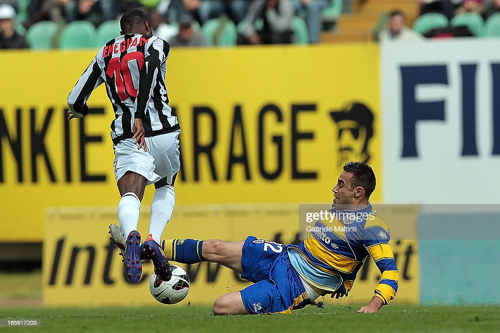 Innocent Emeghara of AC Siena fights for the ball with <a gi-track='captionPersonalityLinkClicked' href=/galleries/search?phrase=Marco+Marchionni&family=editorial&specificpeople=615713 ng-click='$event.stopPropagation()'>Marco Marchionni</a> of Parma FC during the Serie A match between AC Siena and Parma FC at Stadio Artemio Franchi on April 7, 2013 in Siena, Italy.