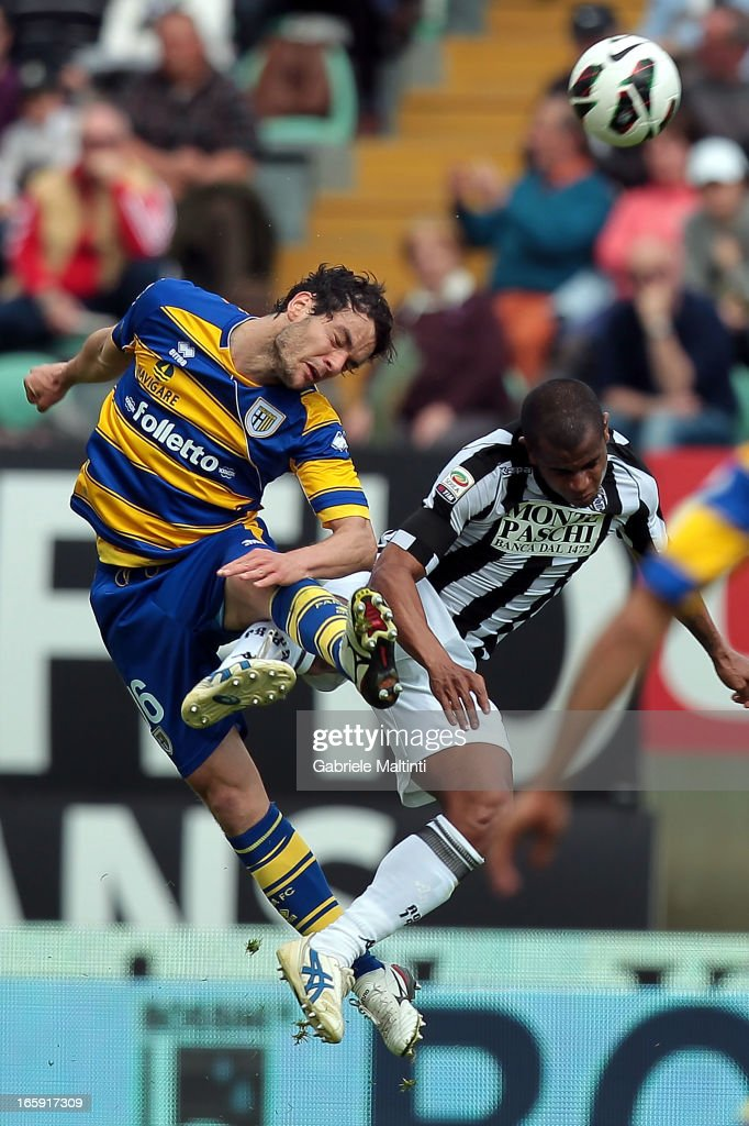 Innocent Emeghara of AC Siena fights for the ball with <a gi-track='captionPersonalityLinkClicked' href=/galleries/search?phrase=Marco+Parolo&family=editorial&specificpeople=6474753 ng-click='$event.stopPropagation()'>Marco Parolo</a> of Parma FC during the Serie A match between AC Siena and Parma FC at Stadio Artemio Franchi on April 7, 2013 in Siena, Italy.