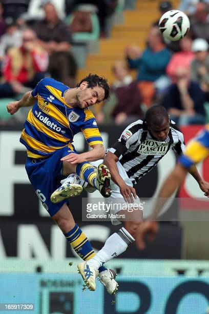Innocent Emeghara of AC Siena fights for the ball with Marco Parolo of Parma FC during the Serie A match between AC Siena and Parma FC at Stadio...