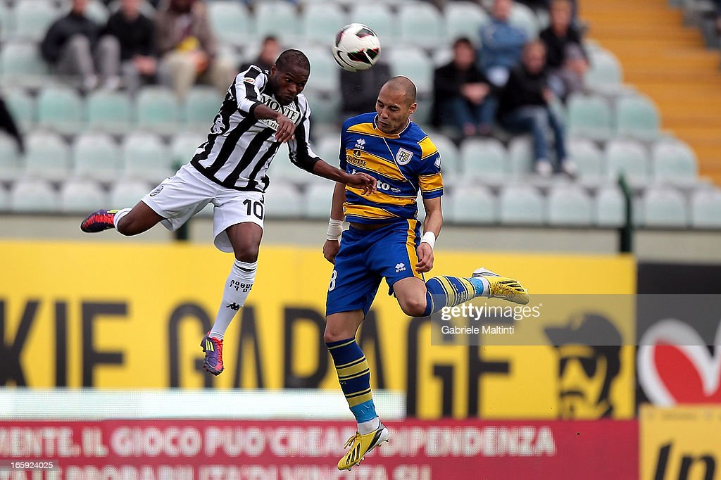 Innocent Emeghara (L) of AC Siena fights for the ball with Yohan Benalouane of Parma FC during the Serie A match between AC Siena and Parma FC at Stadio Artemio Franchi on April 7, 2013 in Siena, Italy.