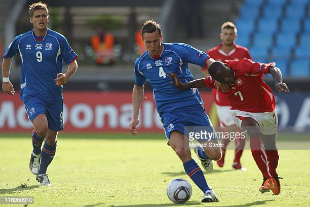 Innocent Emeghara of Switzerland is held back by Eggert Jonsson during the UEFA European Under21 Championship Group A match between Switzerland and...