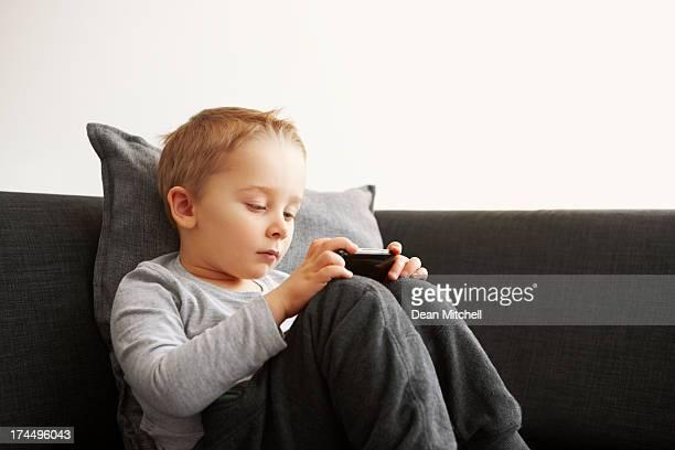Innocent little kid using mobile phone