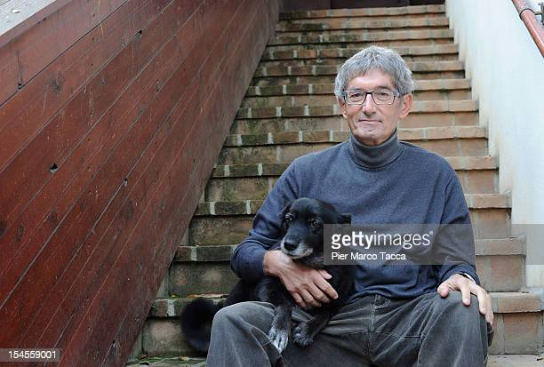 Innocente Marcolini poses with his dog in his home on October 19 2012 in Brescia Italy In a landmark workplace compensation case the Supreme Court in...