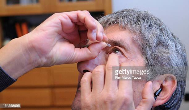 Innocente Marcolini takes his daily medication at home on October 19 2012 in Brescia Italy In a landmark workplace compensation case the Supreme...