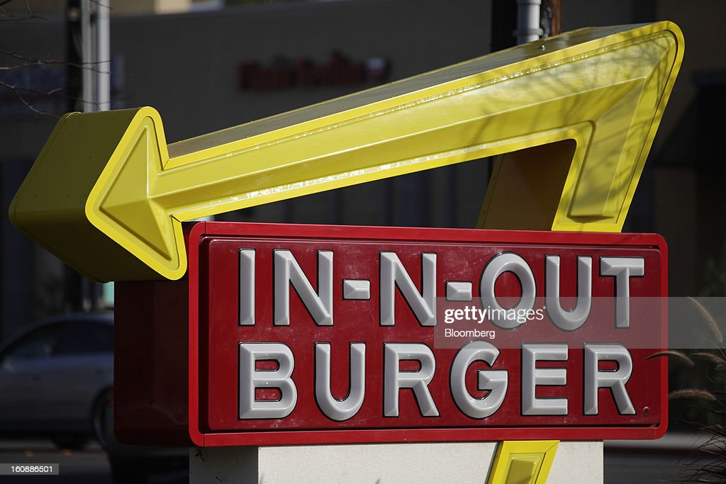 In-N-Out Burger signage stands outside a restaurant in Costa Mesa, California, U.S., on Wednesday, Feb. 6, 2013. In-N-Out, with almost 280 units in five states, is valued at about $1.1 billion based on the average price-to-earnings, according to the Bloomberg Billionaires Index. Photographer: Patrick T. Fallon/Bloomberg via Getty Images