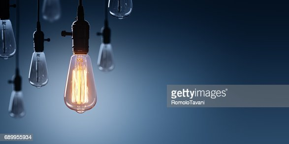Innovation And Leadership Concept - Glowing Bulb lamp : Stock Photo