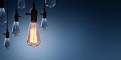 Glowing Bulb On Among Bulbs Off