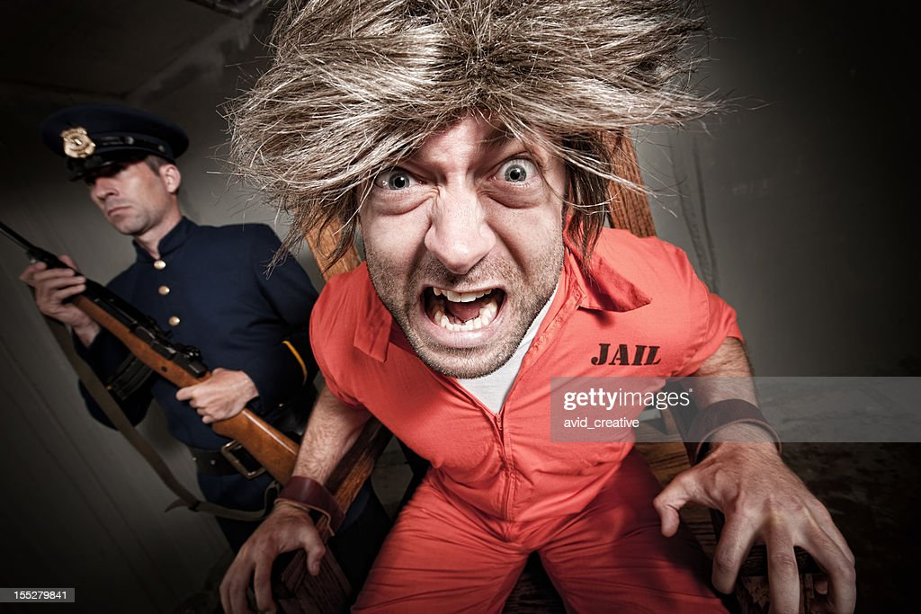 Insane Convict in Electric Chair : Stock Photo