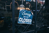 Inscription on a door: Sorry we are closed. Conceptual photo or table on door with information of work. Announcement or work schedule.