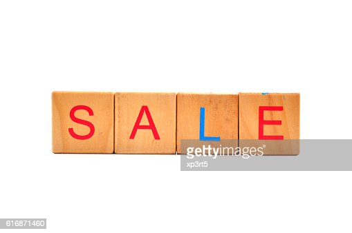 Inscription on the wooden cubes, sale : Stock Photo