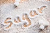 Inscription sugar made into pile of white granulated sugar
