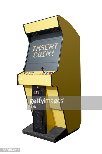 Insert coin on arcade machine : Stock Photo