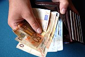 Inserting Euro notes into wallet