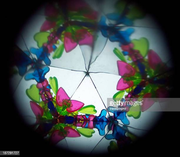 Inside a kaleidoscope, abstract images in blue, green, pink