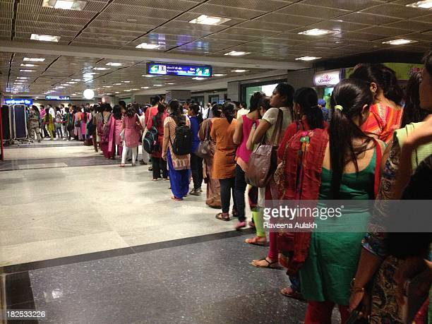 Inside a subway station waiting in a metal detector security lineup in Delhi India September 23 2013