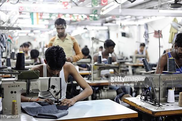 CONTENT] Inside a sweatshop in Dharavi Slum in Mumbai workers produce Jeans for the western market