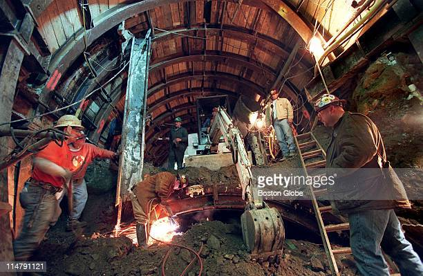 Inside a tunnel 180 feet below the surface of Summer street sandhogs from Local 88 the tunnel diggers union are creating tunnels under the MBTA's Red...