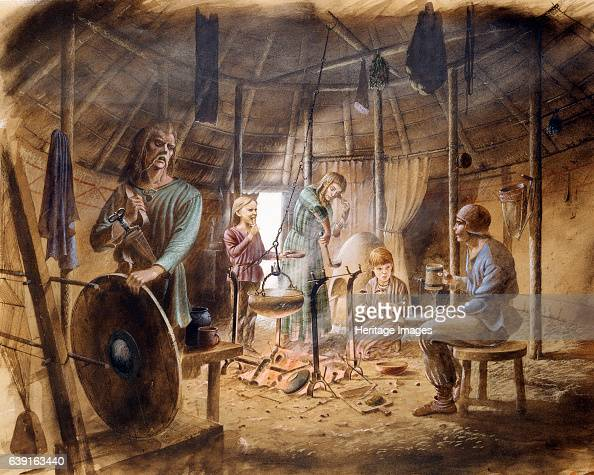 Inside an Iron Age house c5th century BC Reconstruction drawing of interior of hut showing family life in the Iron Age Maiden Castle was an Iron Age...