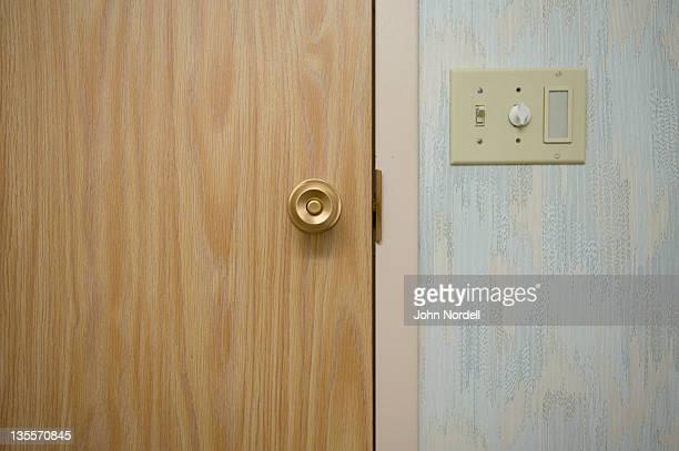 Inside door of a bathroom and light switch