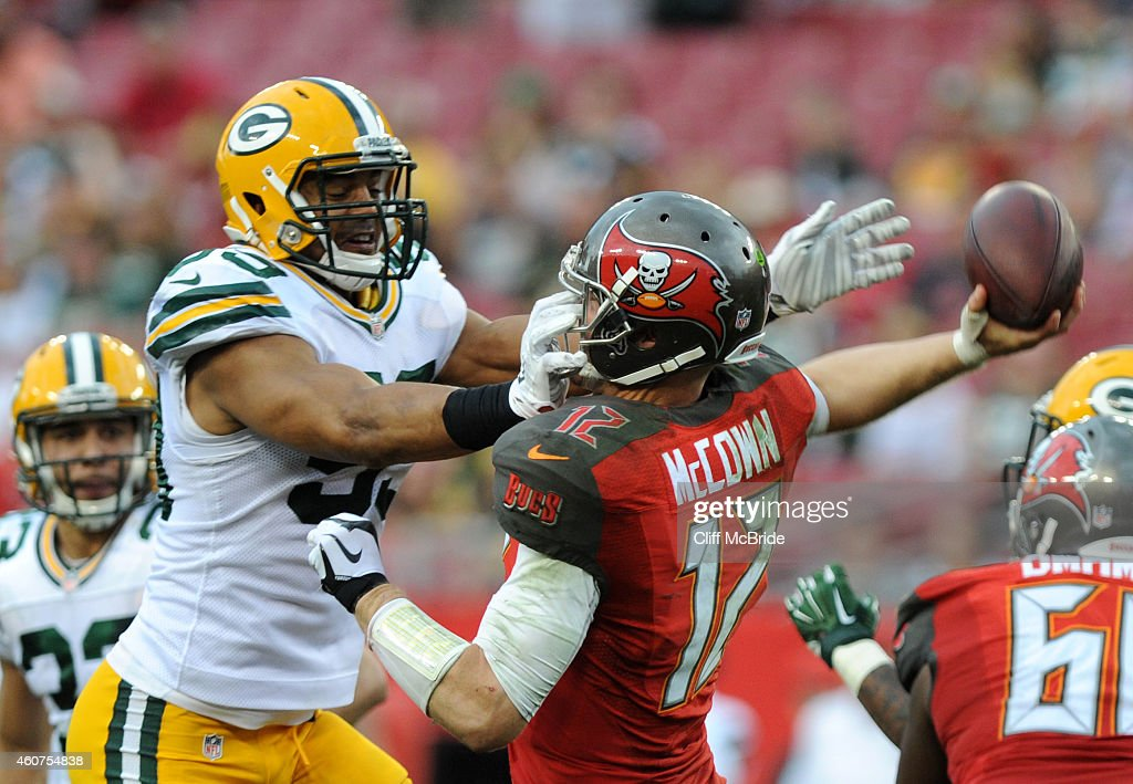 Inside linebacker Brad Jones #59 of the Green Bay Packers puts pressure on quarterback Josh McCown #12 of the Tampa Bay Buccaneers in the fourth quarter at Raymond James Stadium on December 21, 2014 in Tampa, Florida.