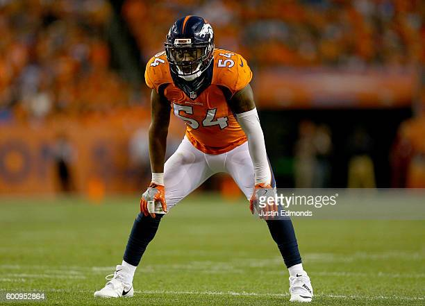 Inside linebacker Brandon Marshall of the Denver Broncos looks on in the first half against the Carolina Panthers at Sports Authority Field at Mile...