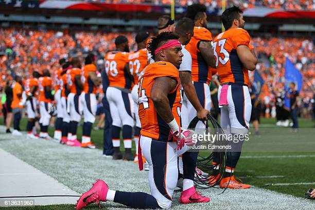Inside linebacker Brandon Marshall of the Denver Broncos on a knee during the National Anthem of the game against the Atlanta Falcons at Sports...