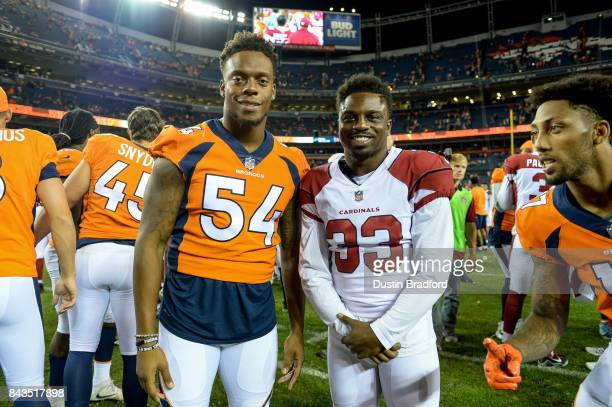 Inside linebacker Brandon Marshall of the Denver Broncos stands for a photo with running back Kerwynn Williams of the Arizona Cardinals after a...