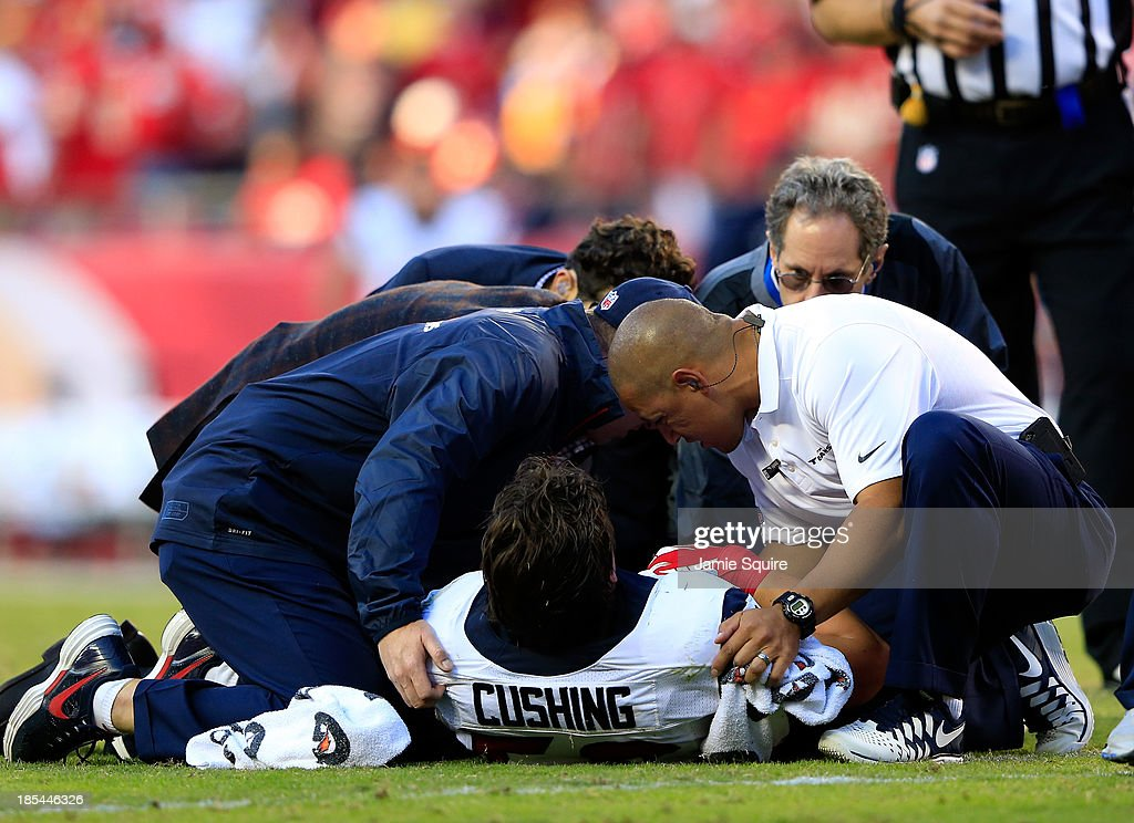 Inside linebacker Brian Cushing #56 of the Houston Texans is attended to after being injured during the game against the Kansas City Chiefs at Arrowhead Stadium on October 20, 2013 in Kansas City, Missouri.