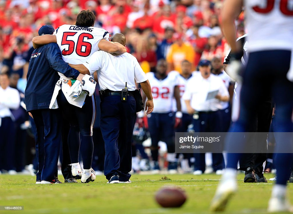 Inside linebacker Brian Cushing #56 of the Houston Texans is helped off the field after being injured during the game against the Kansas City Chiefs at Arrowhead Stadium on October 20, 2013 in Kansas City, Missouri.