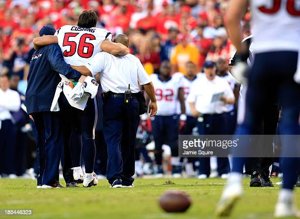 Inside linebacker Brian Cushing of the Houston Texans is helped off the field after being injured during the game against the Kansas City Chiefs at...
