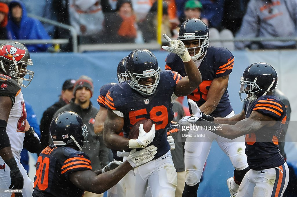 Inside linebacker Christian Jones #59 of the Chicago Bears celebrates after recovering a fumble against the Tampa Bay Buccaneers in the third quarter at Soldier Field on November 23, 2014 in Chicago, Illinois. The Chicago Bears defeat the Tampa Bay Buccaneers 21-13.