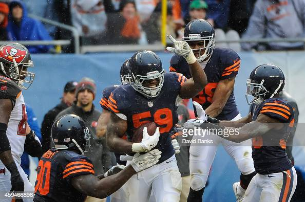 Inside linebacker Christian Jones of the Chicago Bears celebrates after recovering a fumble against the Tampa Bay Buccaneers in the third quarter at...