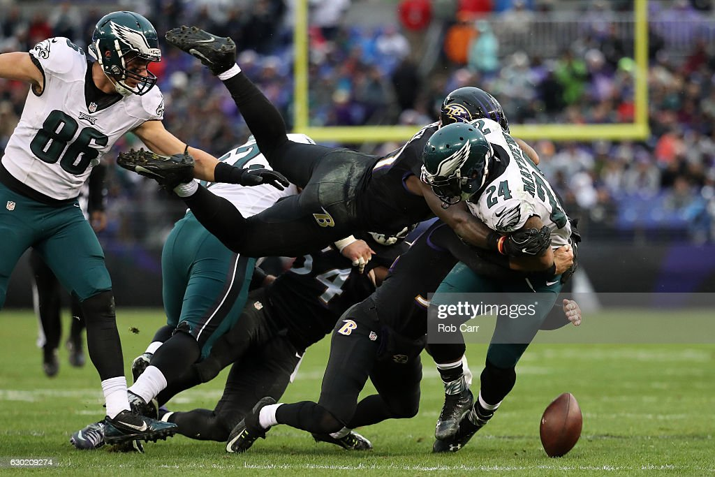 Inside linebacker C.J. Mosley #57 of the Baltimore Ravens knocks the ball loose from running back Ryan Mathews #24 of the Philadelphia Eagles in the second quarter at M&T Bank Stadium on December 18, 2016 in Baltimore, Maryland.