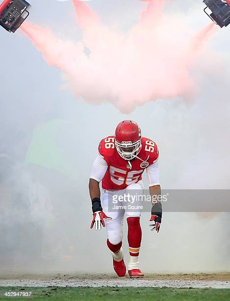 Inside linebacker Derrick Johnson of the Kansas City Chiefs runs through a fog machine while he is introduced prior to the game against the Denver...