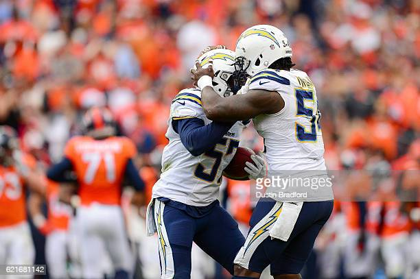 Inside linebacker Jatavis Brown and outside linebacker Melvin Ingram of the San Diego Chargers celebrate a turnover in the third quarter of the game...